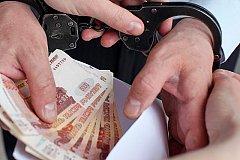 За взятку арестован глава района в Красноярском крае