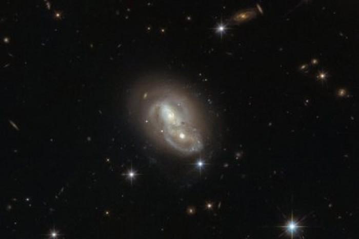 Телескоп «Хаббл» запечатлел быстрые пересекающиеся галактики. Фото: Dosug.md