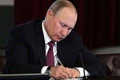 Путин подписал указ о помиловании двух осужденных за госизмену